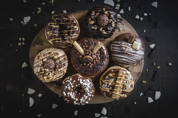 Group of sweet chocolate and homemade donuts,selective focus