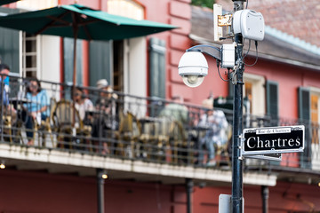 Old town Bourbon Chartres street in New Orleans, Louisiana town, city, cast iron balcony wall corner building, people sitting in restaurant outdoor bar during evening sunset, architecture Fotomurales