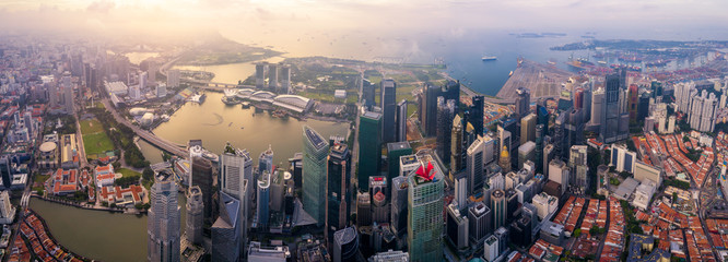 Fototapete - Aerial view of the Singapore landmark financial business district at sunrise scene with skyscraper and over clouds. Panorama of Singapore downtown.