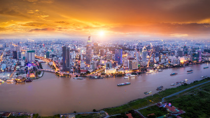 Aerial view of Ho Chi Minh City skyline and skyscrapers in center of heart business at Ho Chi Minh City downtown. Panorama of cityscape on Saigon river in Ho Chi Minh City at Vietnam at sunset scene