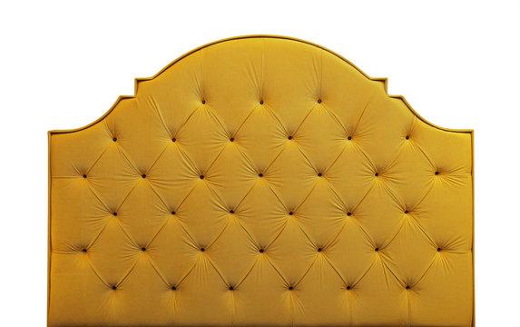 Yellow velvet bed headboard isolated on white