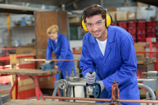 industrial worker wearing earmuffs and goggles