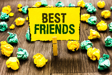 Writing note showing Best Friends. Business photo showcasing A person you value above other persons Forever buddies Clothespin holding yellow note paper crumpled papers several tries.