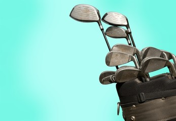 Different golf clubs on background