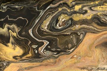 Gold marbling texture design. Beige and golden marble pattern. Fluid art.