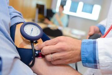 Closeup of blood pressure being taken