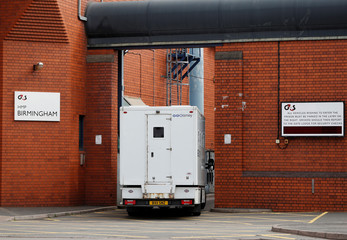 A prison van enters HMP Birmingham after the British government took over its running from G4S, in Birmingham