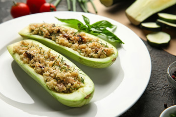 Quinoa stuffed zucchini boats on plate, closeup