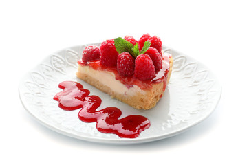 Plate with piece of delicious raspberry cheesecake on white background