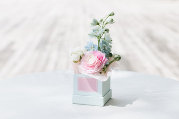 Beautiful spring bouquet with tender pink ranunculus flowers in box, elegant floral decoration