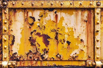 Background panel of rusty grunge iron steel with pealing distressed paint texture and rivets