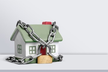 Real estate concept - chain with lock around the home