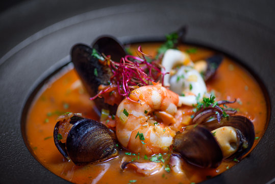 Delicious mediterranean seafood soup with mussels and prawns