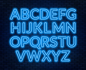 Neon blue alphabet on brick wall background. Capital letter.