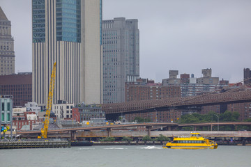 Image of a New York City scene with water taxi in the river