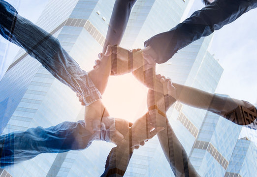 Double exposure ofTeamwork Concept,Group of diversity people to greeting power tag team,Teamwork Join Hands Partnership Concept of people putting their hands together,Friends with hands showing unity.