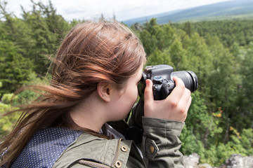 Woman taking pictures of nature