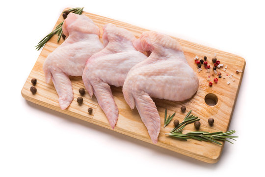 Raw chicken wings with ingredients