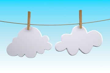 two clouds hanging by clothes peg on a clothesline