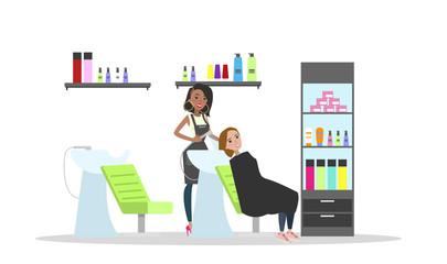 Washing hair with shampoo in beauty salon.