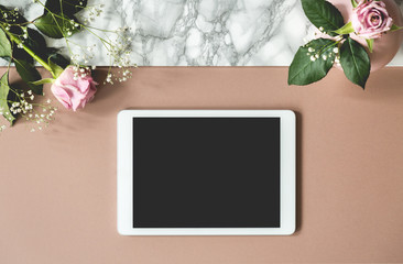 Top view on notepad with mockup on pastel background with pink roses