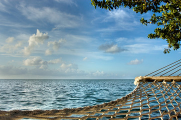 Paradise is a hammock overlooking blue ocean and sky in the Florida Keys.