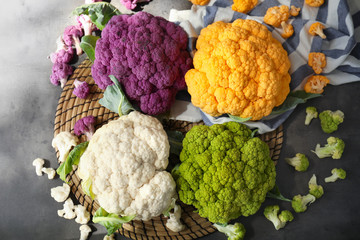 Different cauliflower cabbages on table