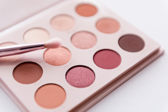 soft focus of pink tone eye shadow palette with pink brush