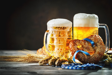 Beer mugs and pretzels on a wooden table. Oktoberfest. Beer festival.