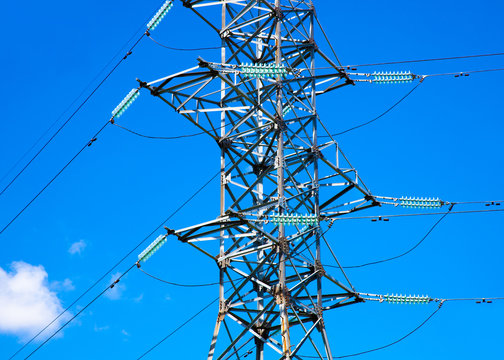 Electricity pylon. Electric power line against blue sky.