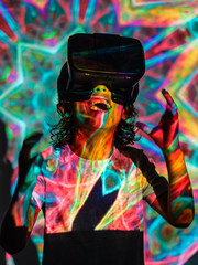 Bright projection on excited boy in VR headset