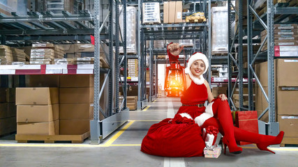 Santa Claus woman in red dress and few gifts.