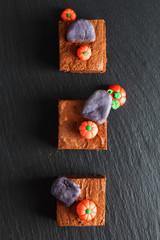 Halloween food idea Homemade organic fudge and crispy brownies with fondants pumpkins on top