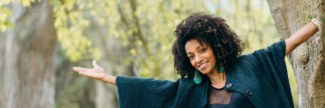 Joyful stylish black woman in autumn