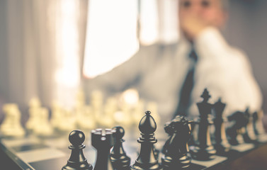 business man chess figures and bitcoin, strategy concept