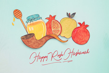 Rosh hashanah (jewish New Year holiday) concept. Traditional symbols shapes cut from paper and painted.