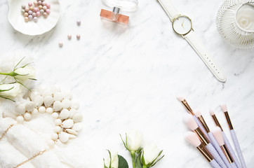 Feminine accessories on a marble dressing table. Top view, flat lay