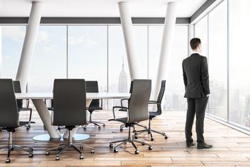 Pensive businessman in meeting room