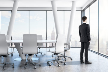 Thoughtful businessman in conference room