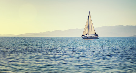 Fototapete - Sailing yacht in Mediterranean sea at sunset. Travel and active lifestyle concept