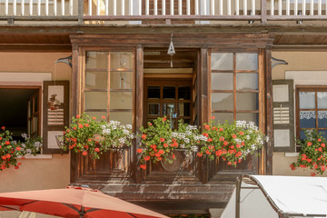 blossomimng traditonal wooden bow-window,  Gressoney Saint Jean, Italy