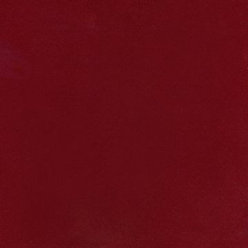 texture of the burgundy velvet. The background of burgundy cloth. .