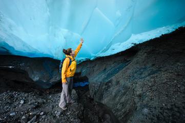 Touching the Mendenhall Glacier, Juneau, Alaska.