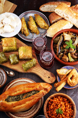 Middle eastern or arabic dishes and assorted meze, concrete rustic background. sambusak. Turkish Dessert Baklava with pistachio. Sarma. Halal food. Lebanese
