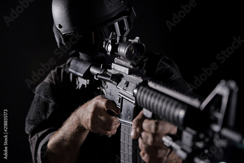 Spec ops police officer SWAT in black uniform