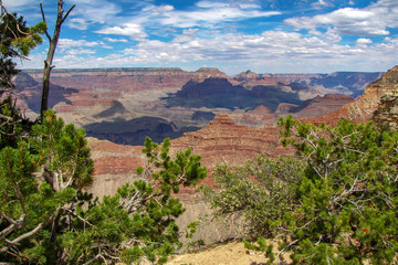 Panoramic view of the Grand Canyon National Park, with clouds casting shadows on the mountains, picture taken from the South Rim, Arizona, USA