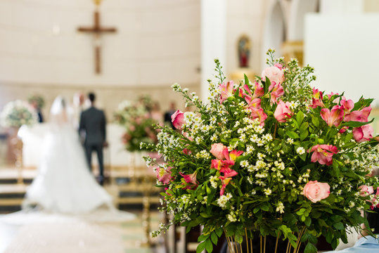 Catholic church decoration for wedding ceremonies - bride and groom on the bare bottom