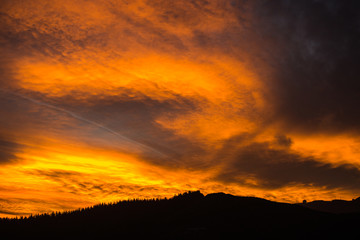 Epic fiery sunset above the tree line 2
