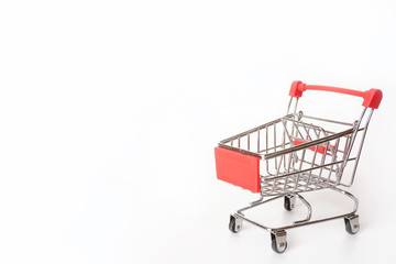 Red Shopping cart or supermarket cart on white background with copy space