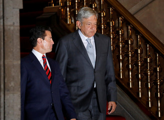 Mexico's incoming president Andres Manuel Lopez Obrador  and  President Enrique Pena Nieto arrive to attend a joint press conference after having a meeting at National Palace in Mexico City
